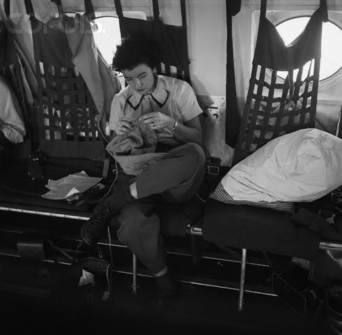 12 26 13 Soldier Knits on Military Plane Korea 1953