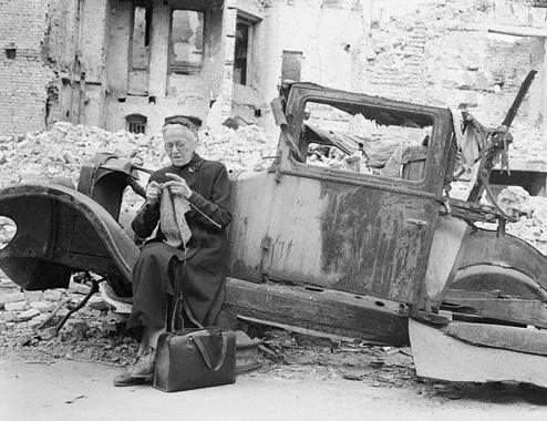 German Woman Knitting in Ruins of Berlin 1945