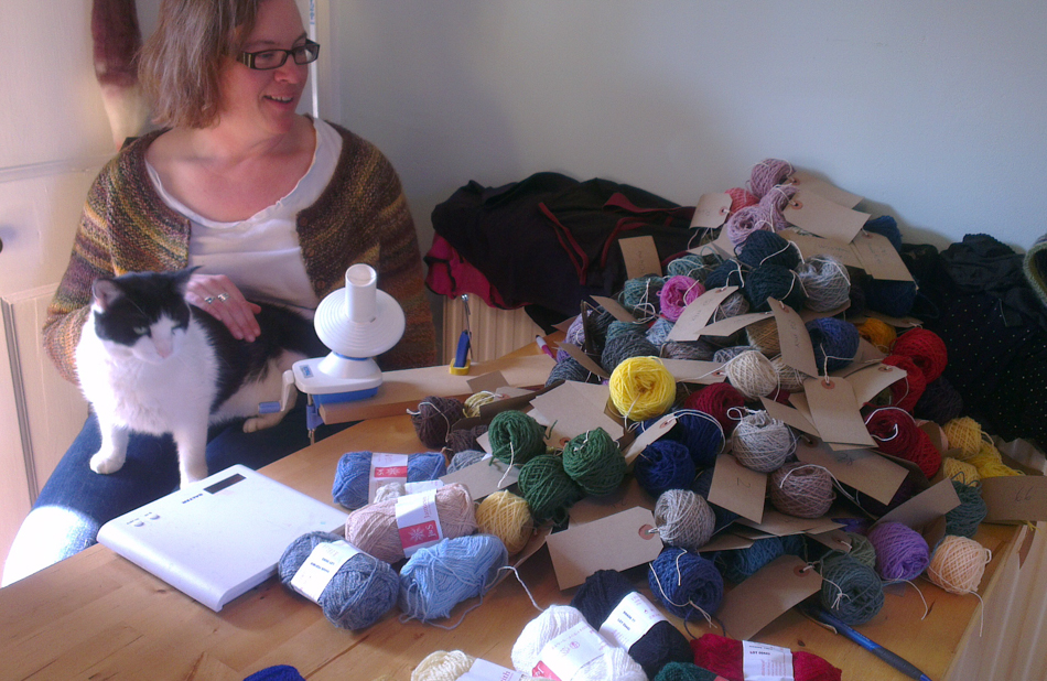 Splitting balls of yarn - hours of work, not including the extra hassle provided by an interfering cat!