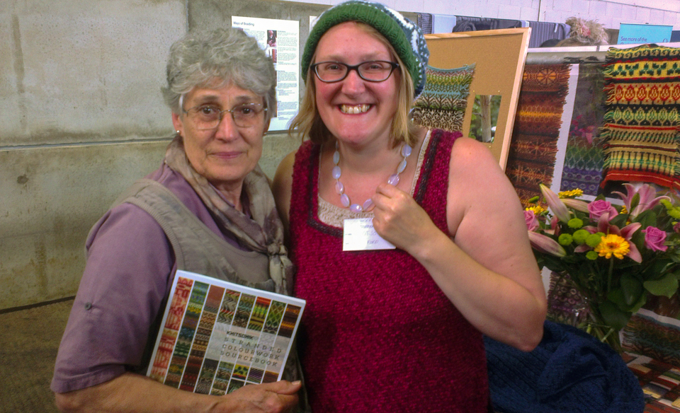 Carol Thorpe from the Oxford Guild of Weavers, Spinners and Dyers turning up on the KNITSONIK stall at WOOLFEST - one of many social highlights of the show!
