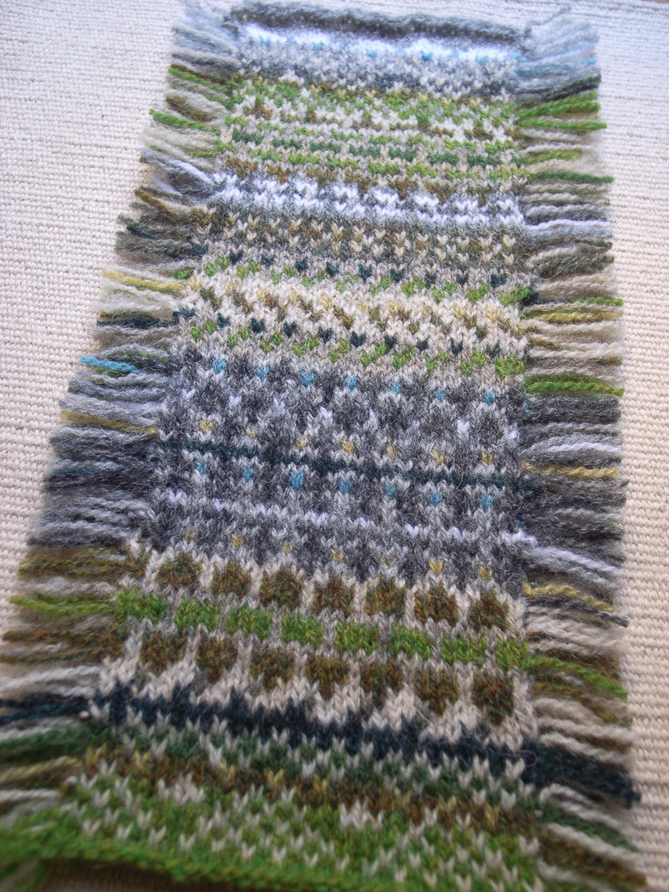 Silchester mitts-a-long swatch
