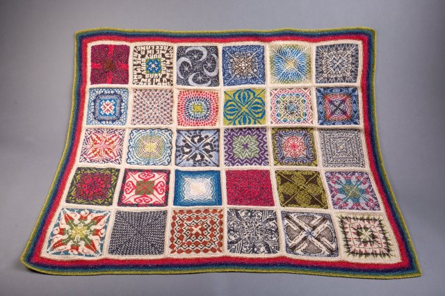 celebratory stranded colourwork blanket, made up of many different, intricately-designed squares