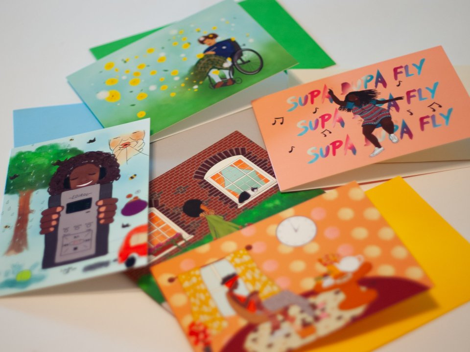 A collection of greeting cards by Eclectic Gift for KNITSONIK, arranged with their colour co-ordinated envelopes