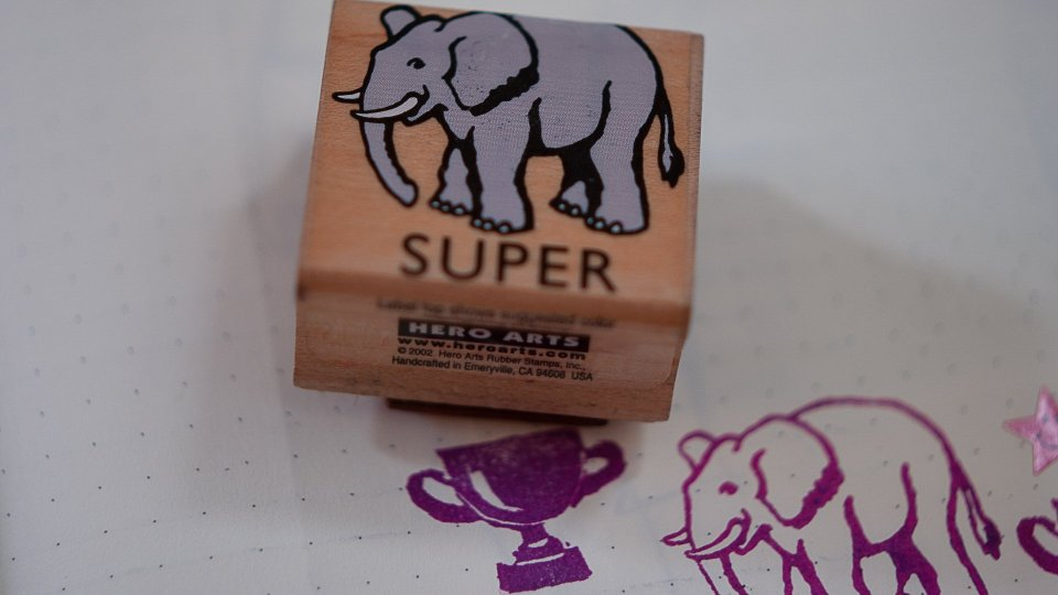 A SUPER stamper featuring the word SUPER and an elephant