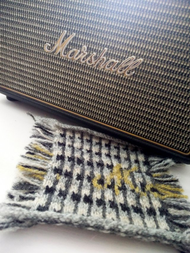 The amplifier-speaker and the knitted postcard that it has inspired