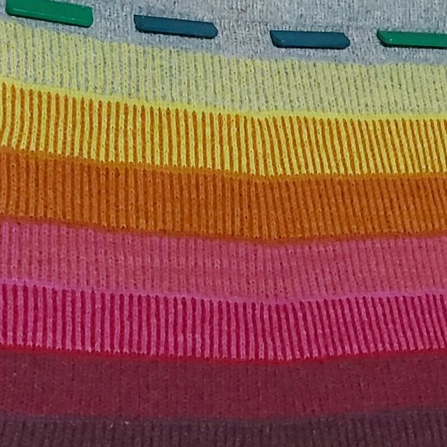 closeup of the stranded colourwork details in Tower of Strength by Jimenez Joseph