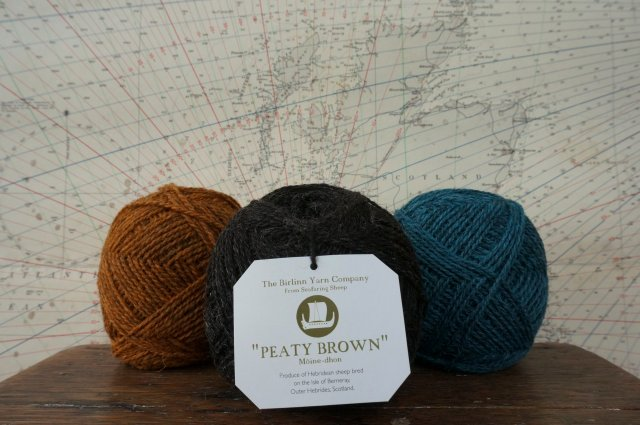 Gorgeous woolly yarns from The Birlinn Yarn Company, shown in context against an old map of Scotland