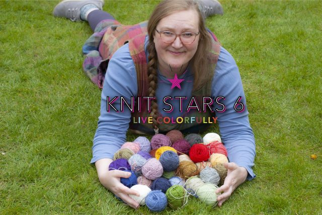 Felix lolls on the grass in a multicoloured playsuit, cradling many balls of wool in her arms. KNIT STARS LIVE COLORFULLY is superimposed in the middle of the picture