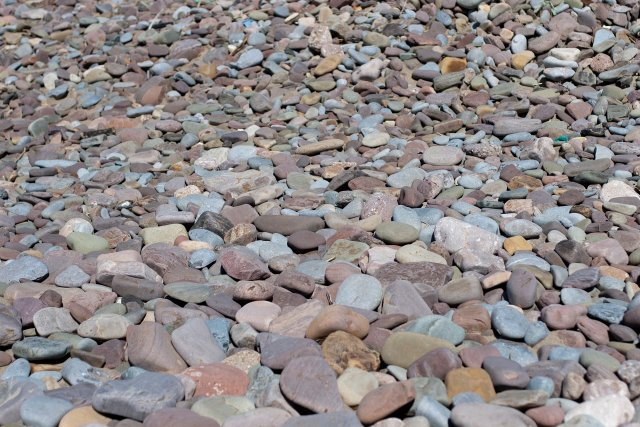 a collection of beautifully-coloured stones on Rhossili beach