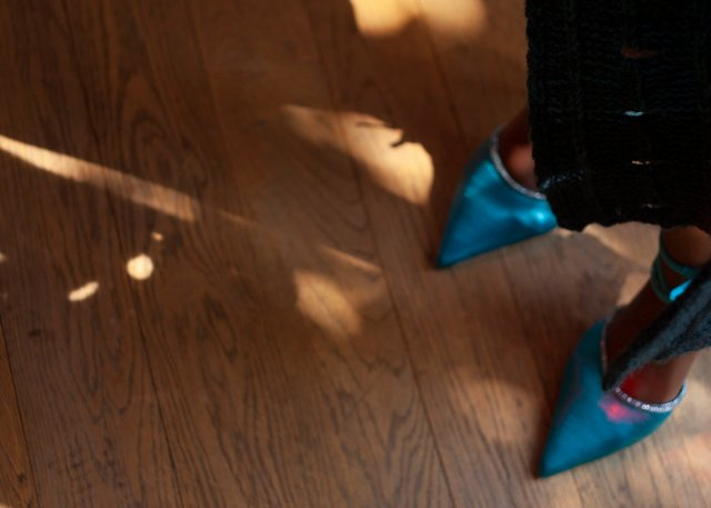 intriguing image of beautiful silky turquoise shoes and glimpse of edge of knitwear, with holes and light coming through... you can see light, and lace, shadows, and just the barest hint of the edge of a piece of knitwear...