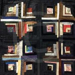 An extensive use of black gives this quilt a sombre feel