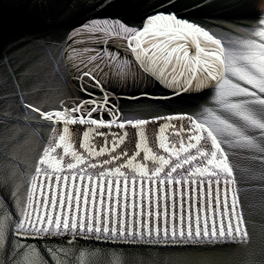 black and white hat in progress, about 2/3 done
