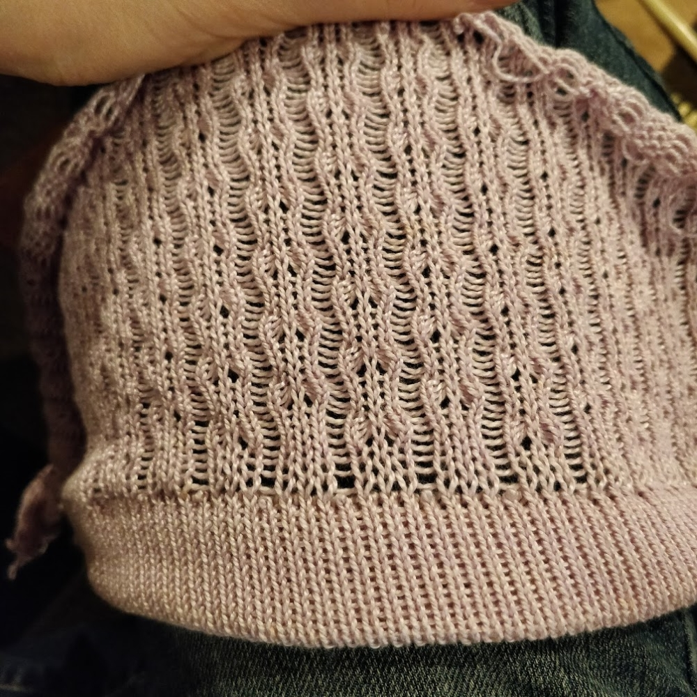 "A pale pink swatch of tuck lace, with vertical ""ribs"" of dropped stitches surrounding wavy lace columns."