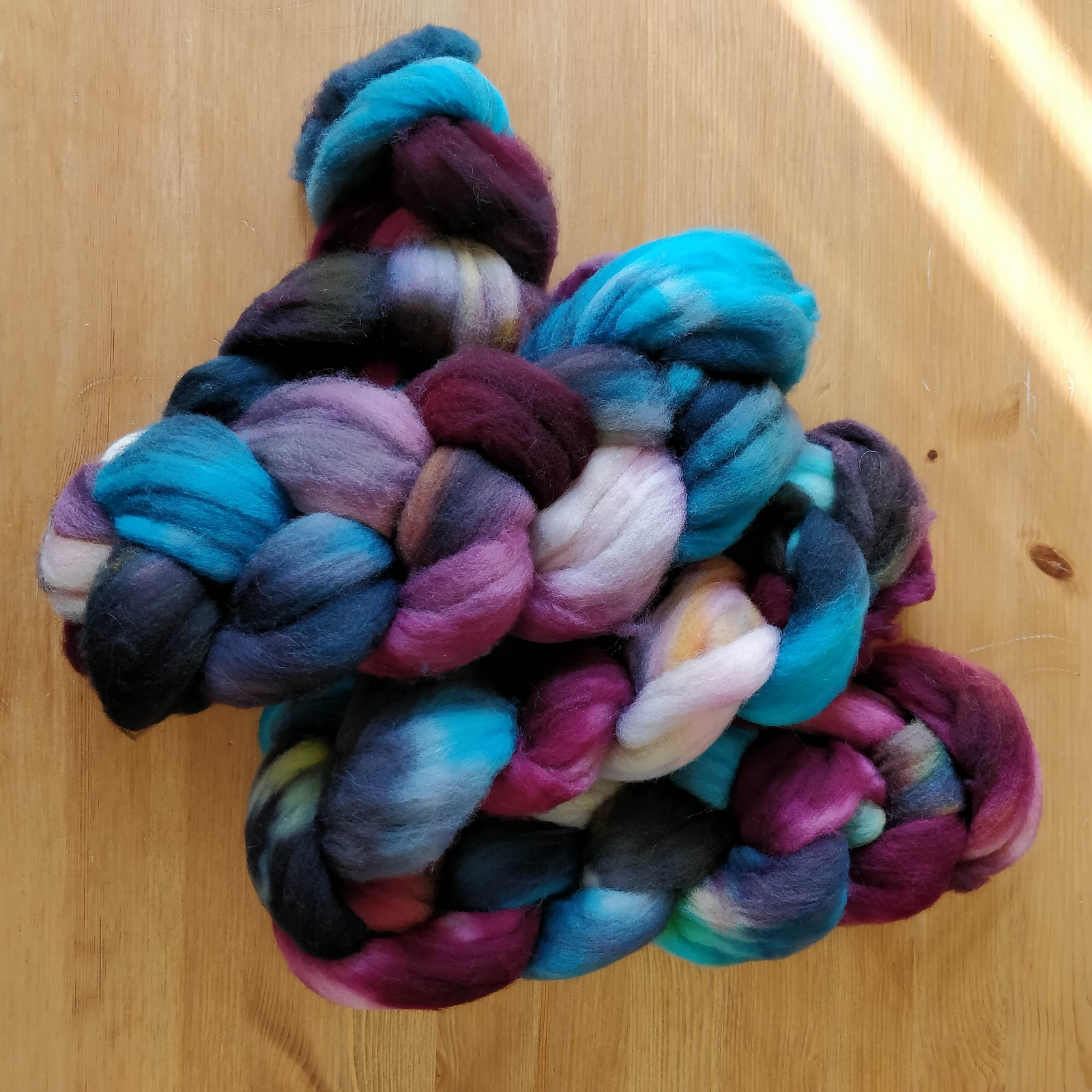 Eight ounces of Targee wool in teal and pink