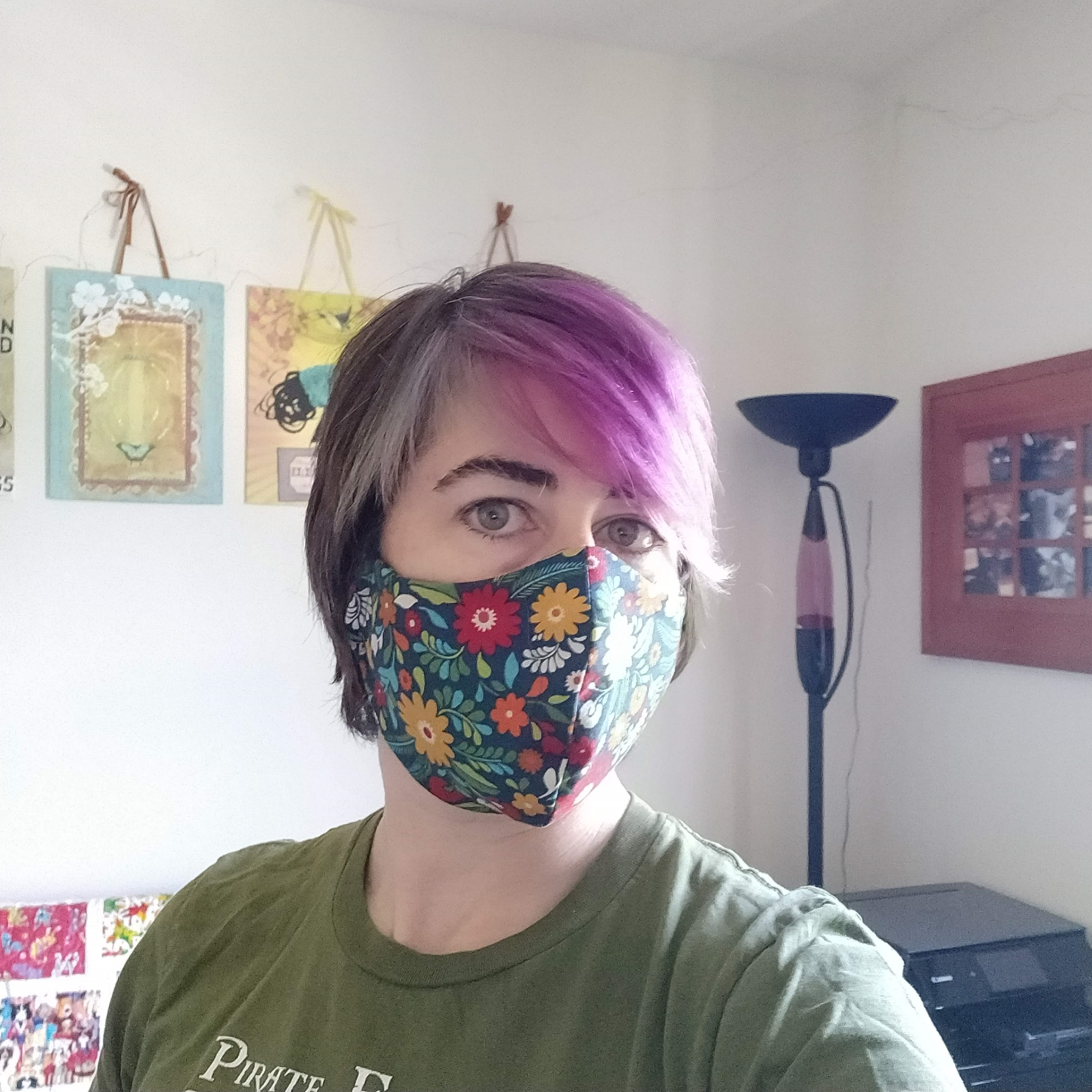 Pirate models a mask sewn from a cute flowery fabric.