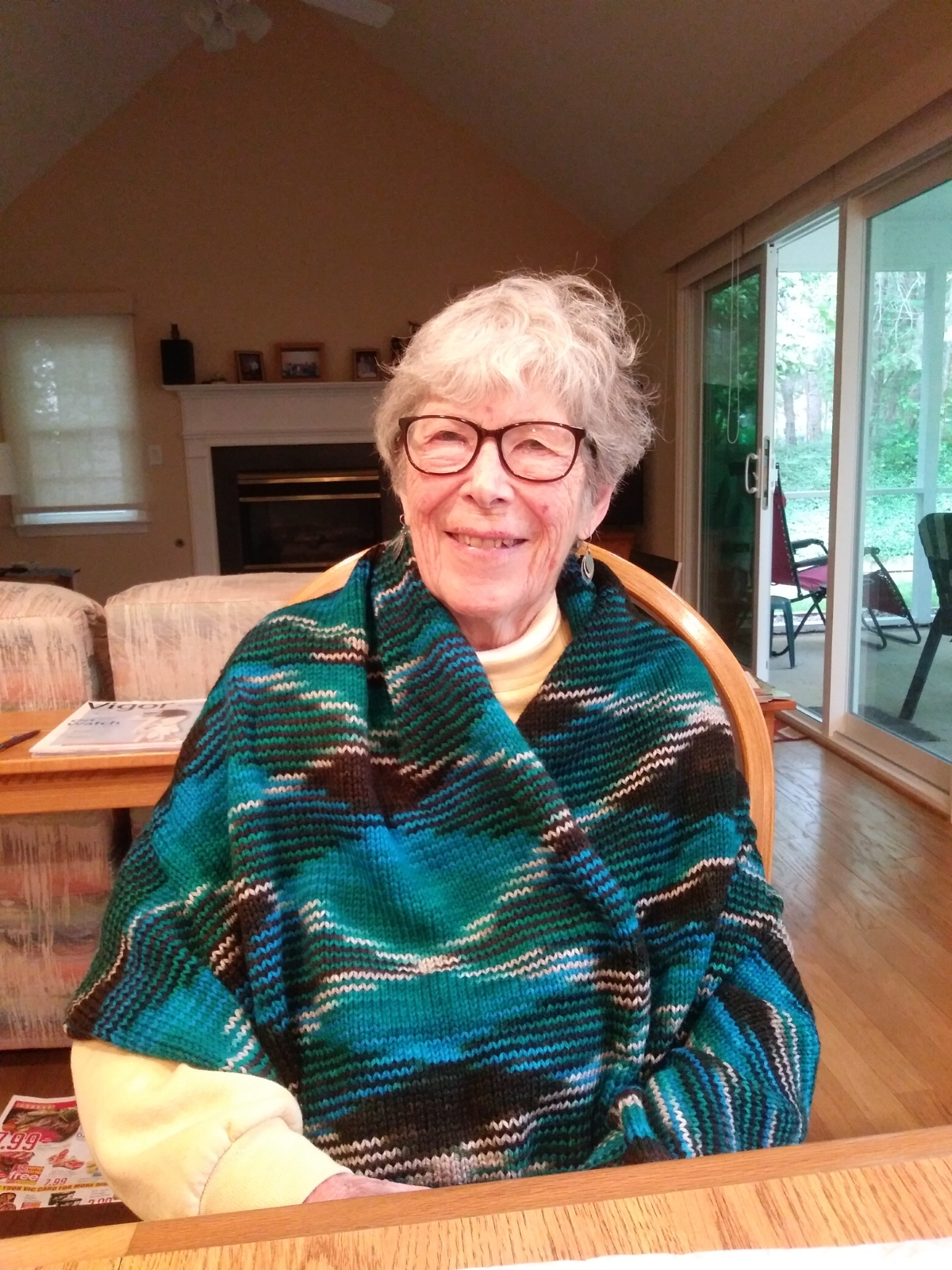 Pirate's grandma models her new teal and brown wrap.
