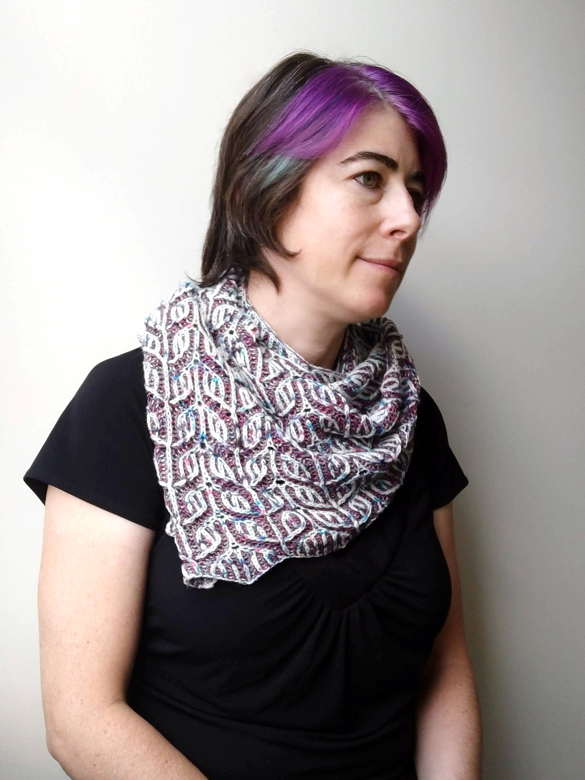 Pirate modeling the Sizzle Pop Shawl