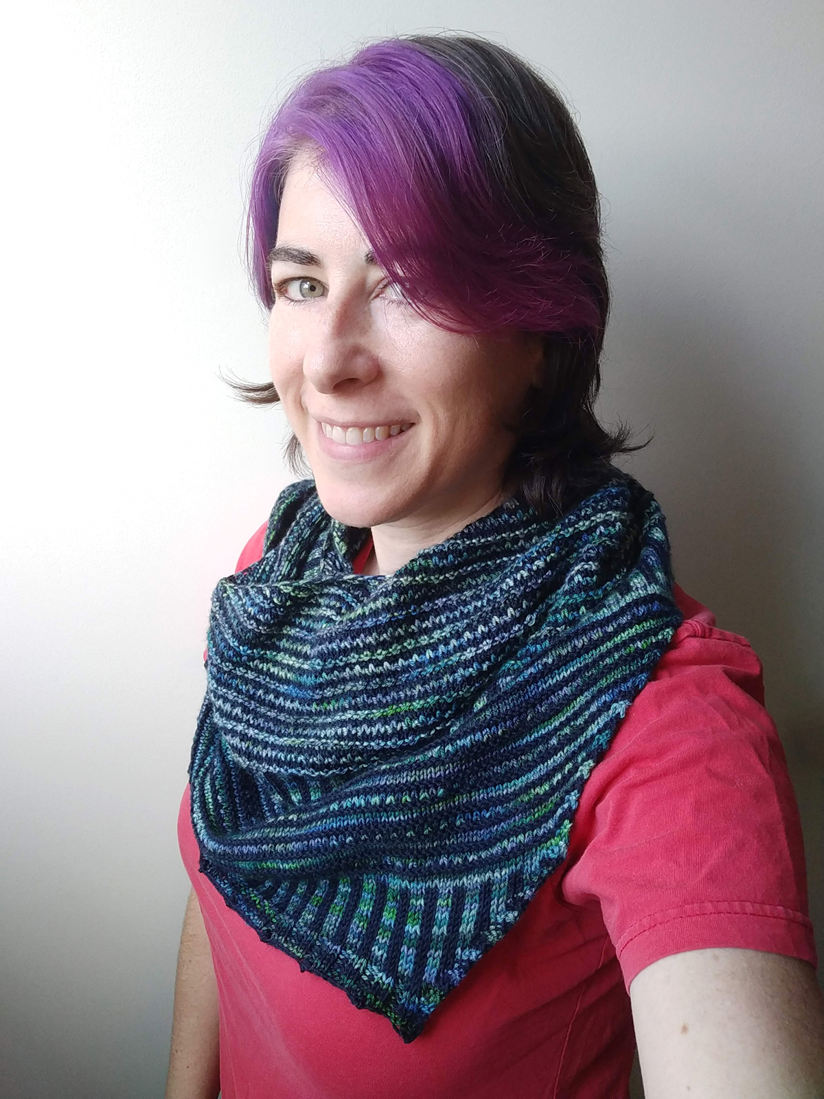 Pirate modeling the Breathe and Hope shawl