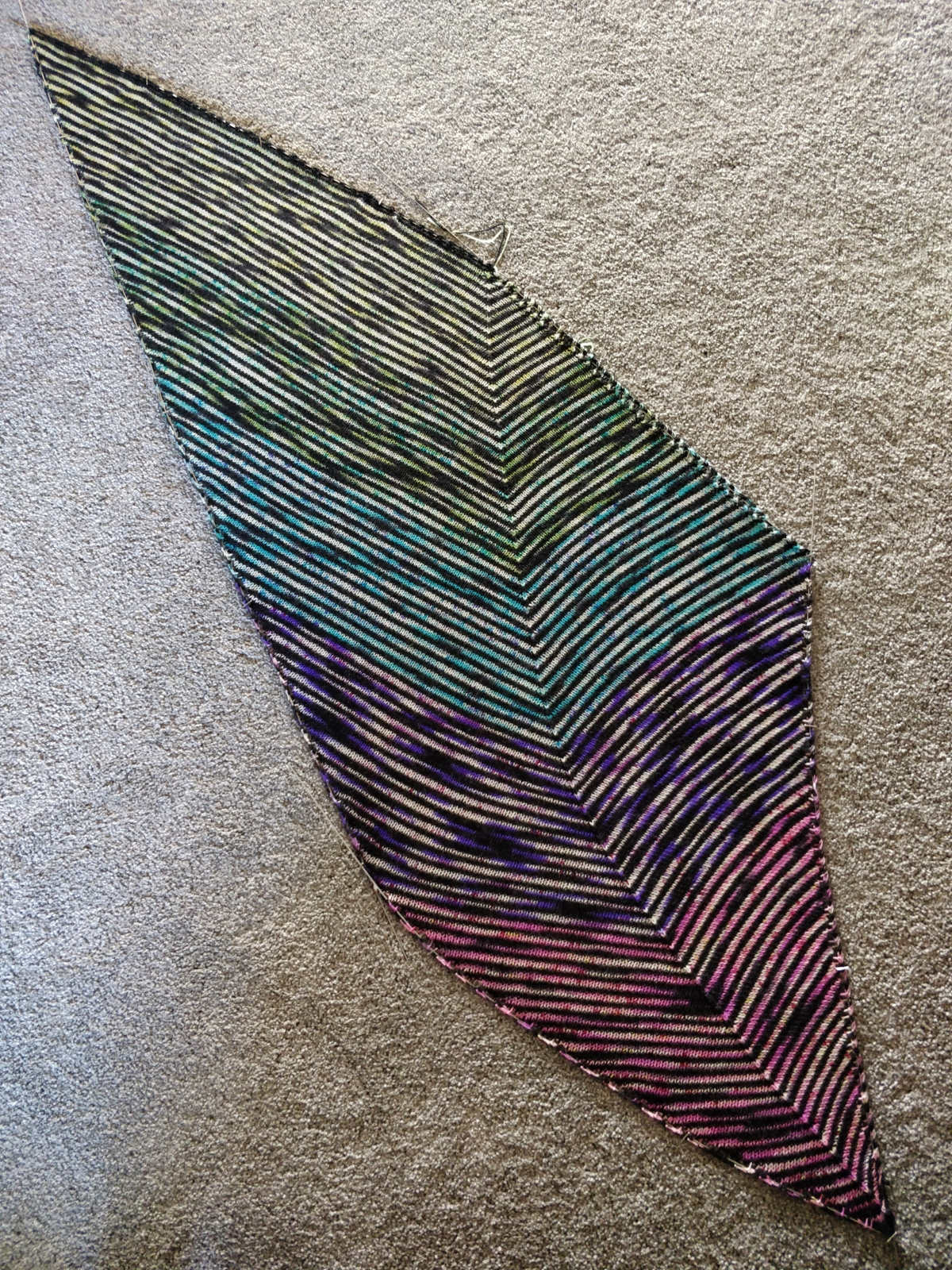 The Which Way shawl, pinned out on the floor