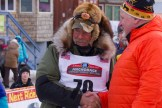 Receiving congratulations from Iditarod Trail Committee Executive Director Stan Hooley