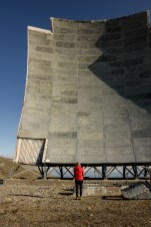 Caitlin in front of a microwave transmitter tower, Tin City, Alaska.