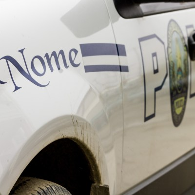 Close-up of a white Nome Police Department vehicle.