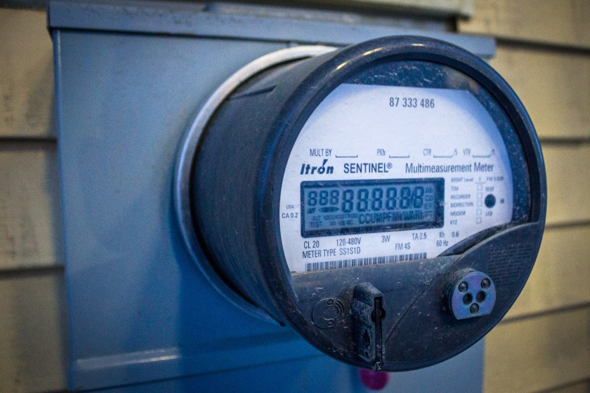 A close-up view of a utility meter on the side of a Nome building.