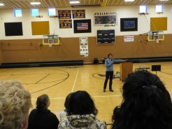 Sen. Lisa Murkowski speaks to students and community members at the Unalakleet School gym on Friday. Photo: Laura Kraegel, KNOM.
