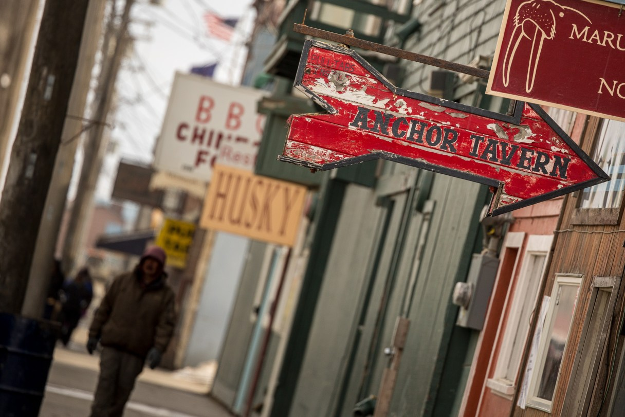 Businesses on Nome's Front Street, including the Anchor Tavern, Husky, Golden China, and Maruskiya's gift shop.