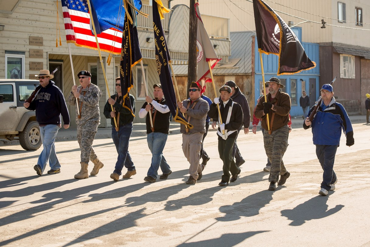 Veterans carry flags in Nome's Memorial Day parade.