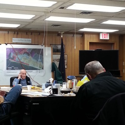 City Council members gather around the table during a work session followed by regular meeting. Photo Credit: Davis Hovey, KNOM (2017)