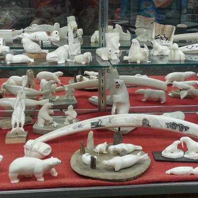 Various carvings made from ivory on display at Maruskiya's in Nome. Most of these pieces are made from walrus ivory. Photo Credit: Davis Hovey, KNOM (2017)