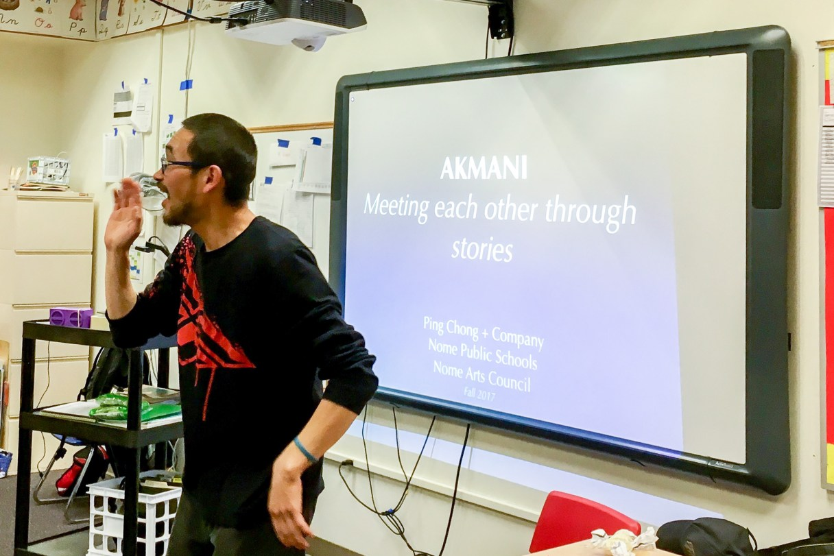 Man gives a dance performance inside a Nome Elementary School classroom.