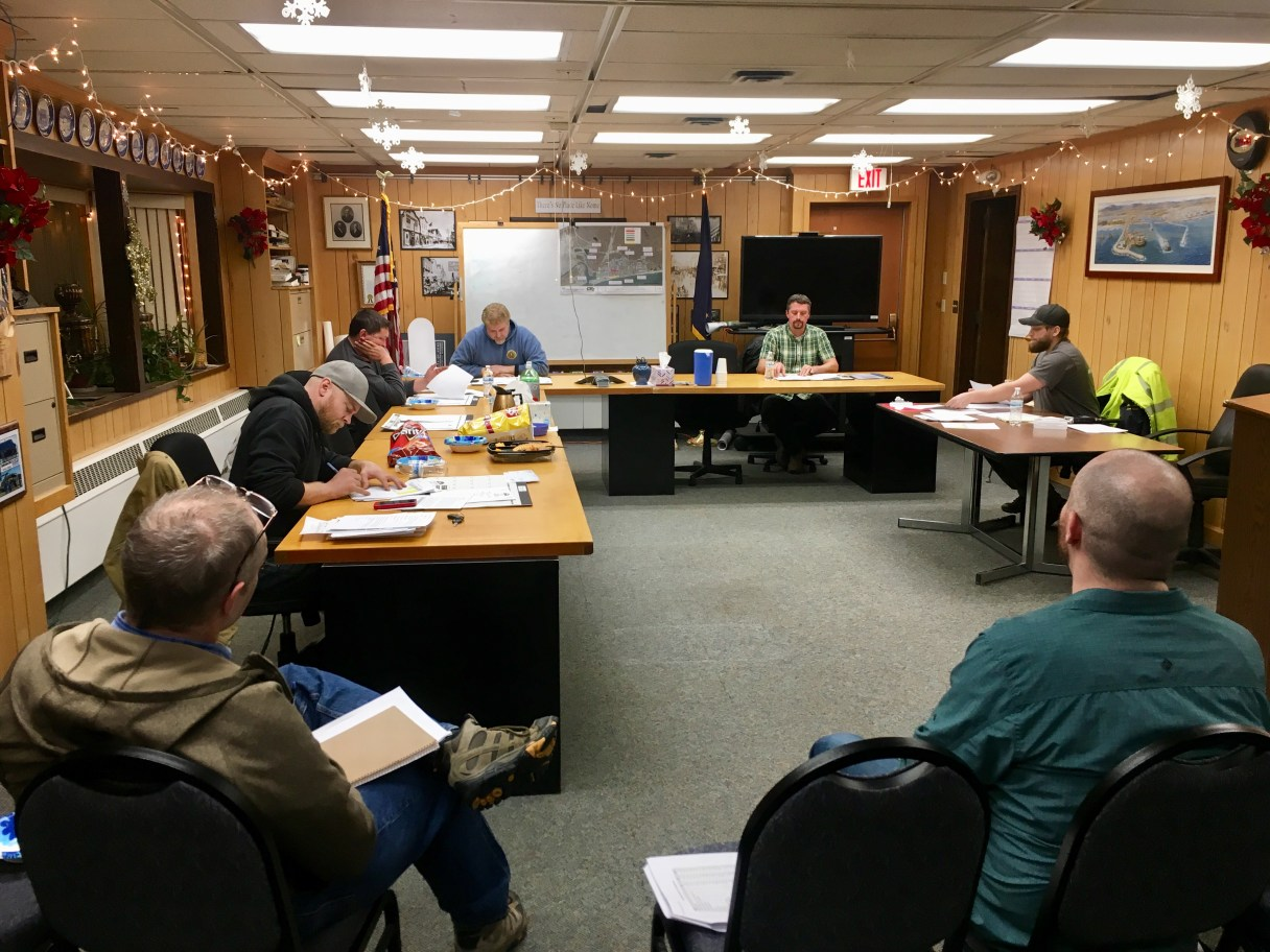 The Nome Port Commission at their regular meeting on Dec. 14, 2017 in a festively decorated Council Chambers.