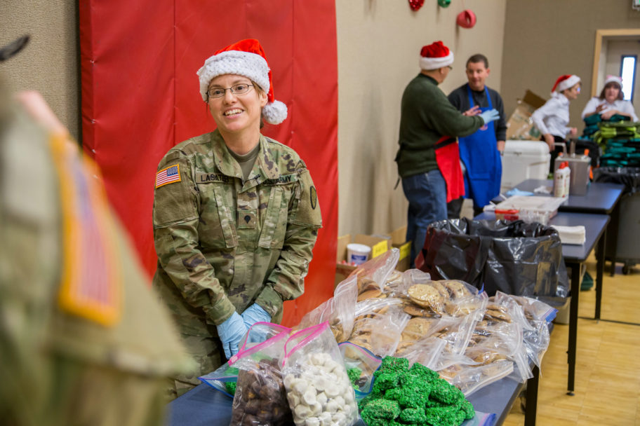 Volunteers with Operation Santa Claus prepare gifts and goodies for the children of St. Michael.