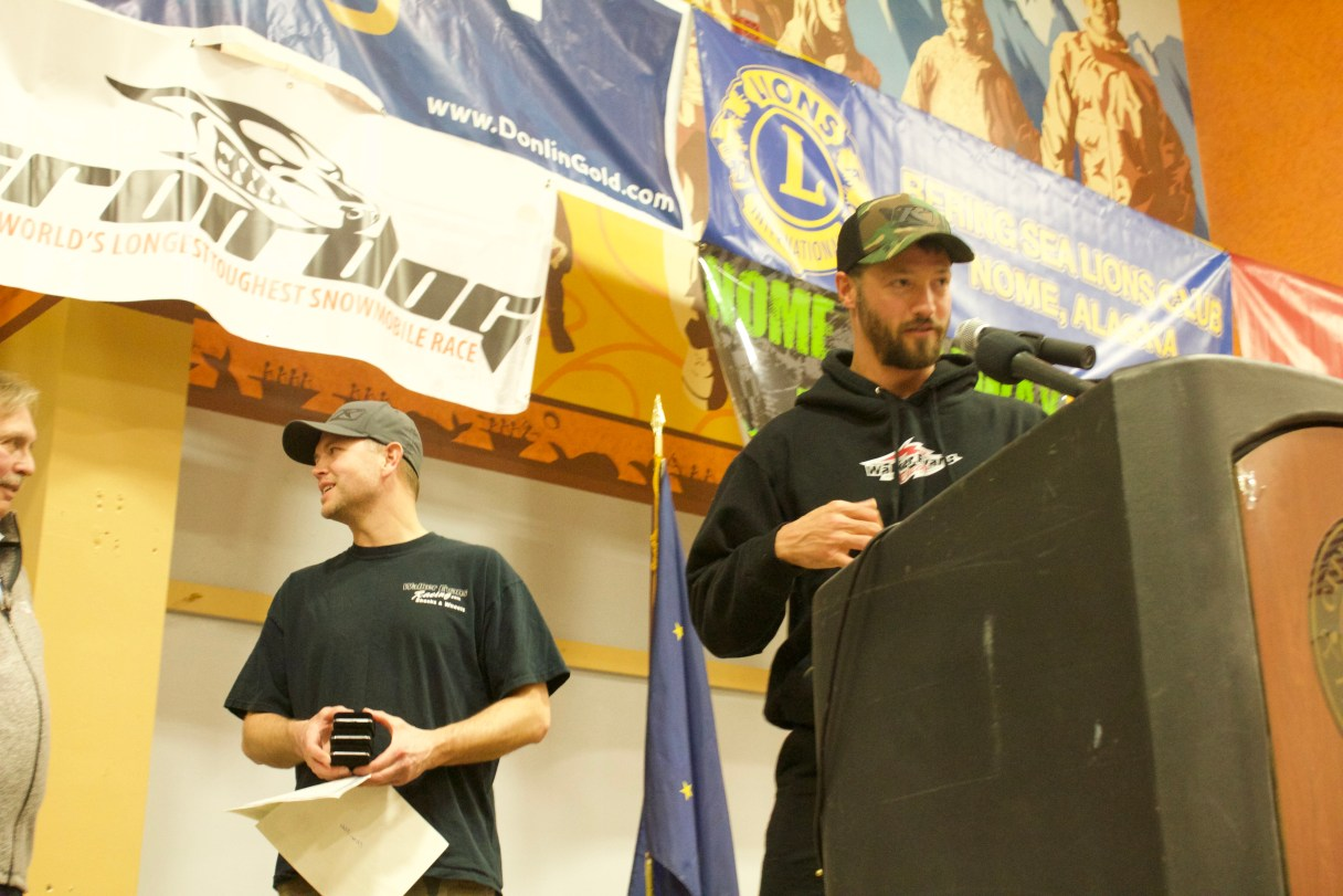 Mike Morgan of Nome and racing partner Chris Olds receive awards for being fastest team into Nome in 2018 Iron Dog race. Photo Credit: Gabe Colombo, KNOM (2018)