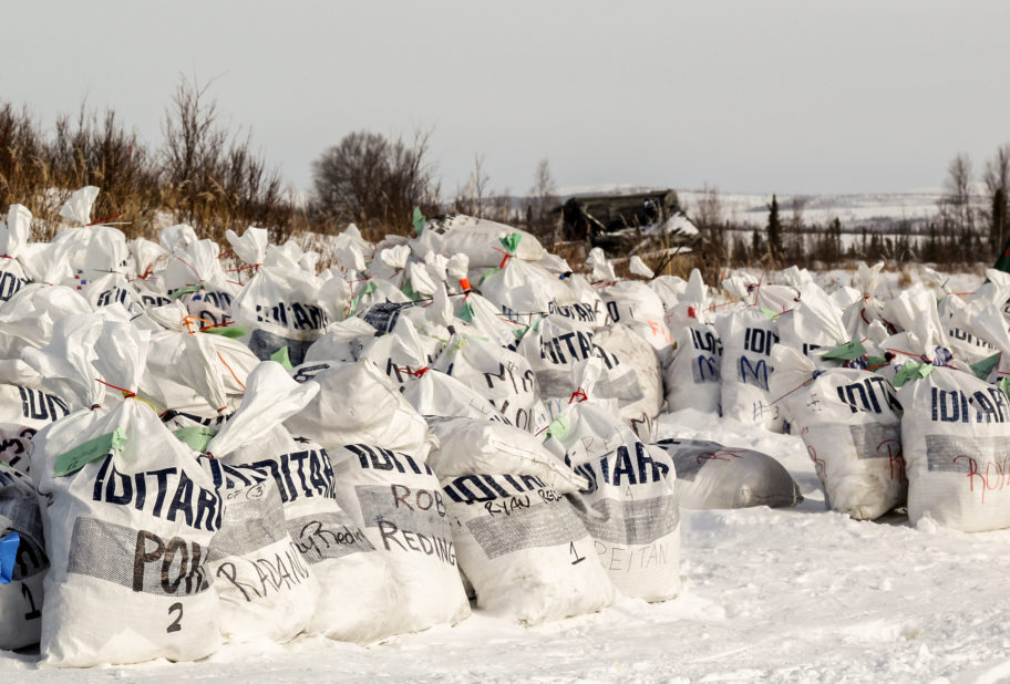 A large group of drop bags at the Iditarod checkpoint.