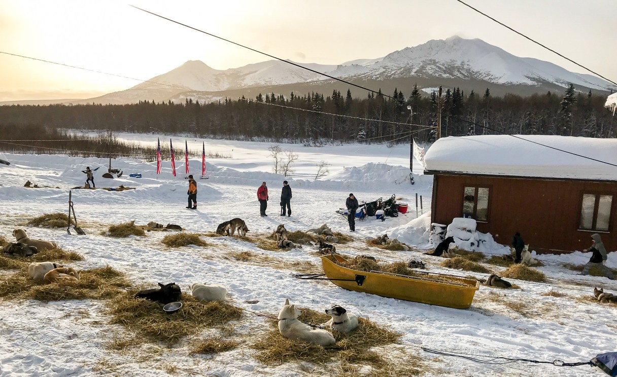 A mid-afternoon, snowy landscape of Takotna checkpoint and the surrounding, mountainous countryside.