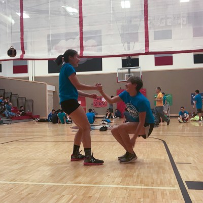 NYO competitors from Unalakleet lend each other a helping hand at the 33rd annual BSSD NYO Tournament.