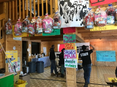 Handmade signs welcoming mushers and Easter baskets for local kids brighten the Ambler community hall, which serves as checkpoint headquarters during the Kobuk 440.