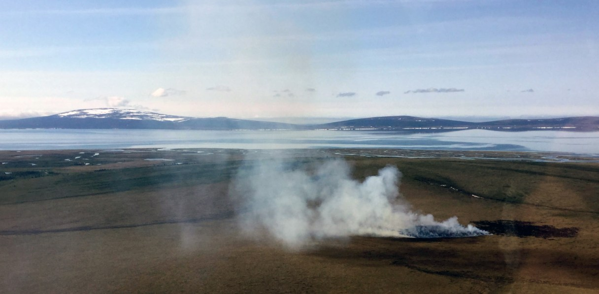 An aerial view of smoke rising from a fire near the village of Golovin, Alaska.