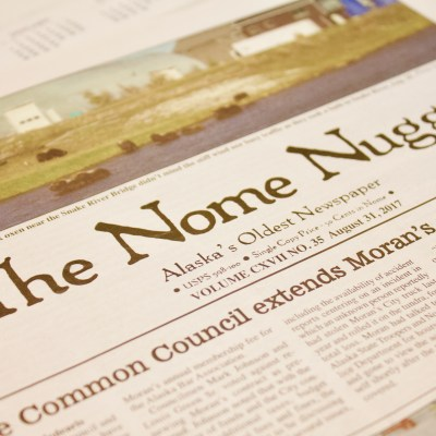 A Nome Nugget newspaper on a table
