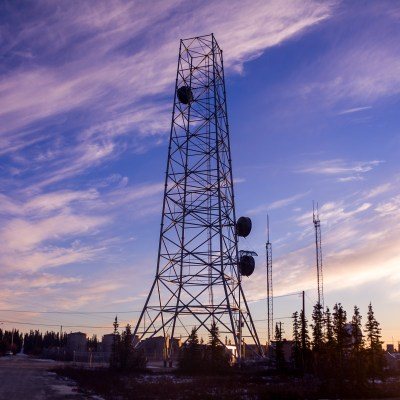 Silhouette of internet tower in Noorvik, Alaska, at sunset.