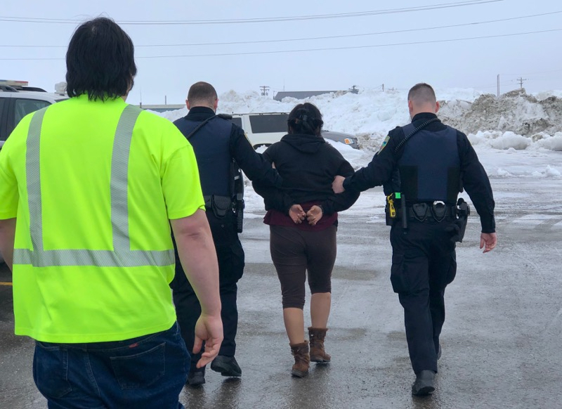 Evak was escorted away from the airport in handcuffs by Nome Police. Photo provided by Carol Gales (2019)