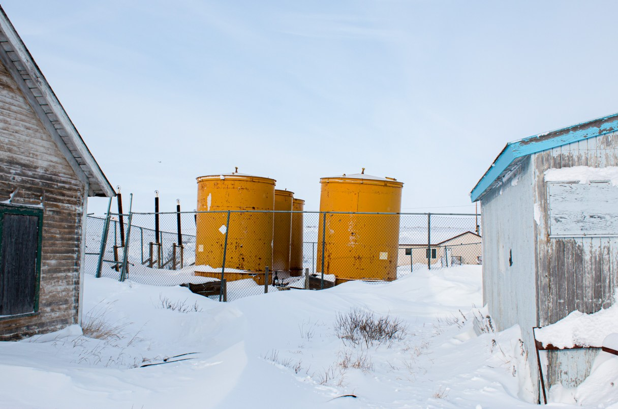 A picture of yellow fuel tanks in St. Michael, Alaska.