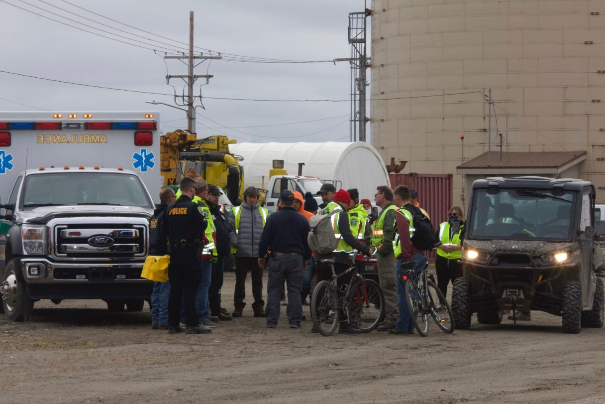 Searchers gather by the Snake River in community-wide search on Satruday.