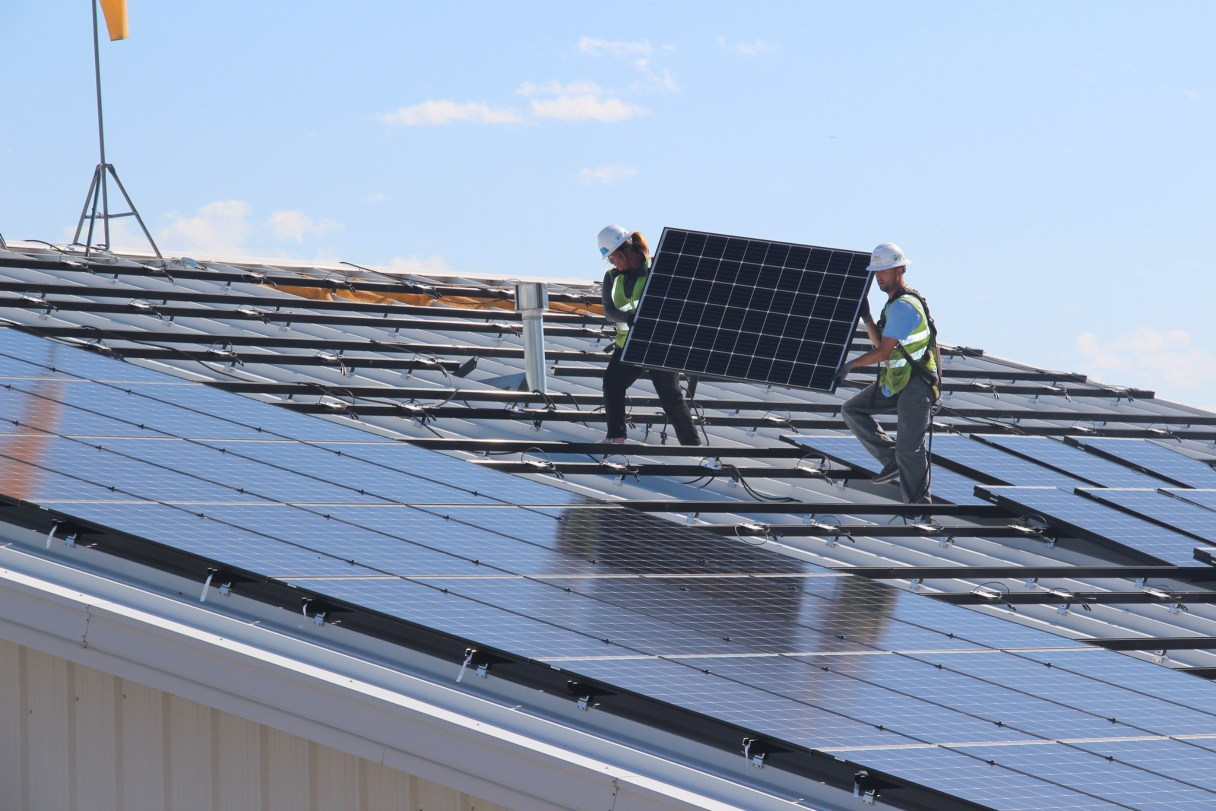 GRID workers place solar panels on a building in Spokane, Washington. Photo Courtesy of GRID Alternatives.