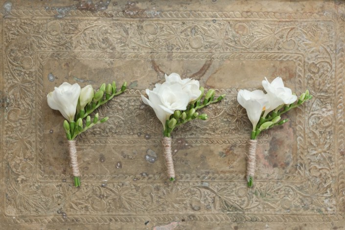 Freesia boutonniers wrapped in twine