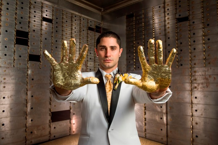 metal and gold wedding inspiration groom with gold hands