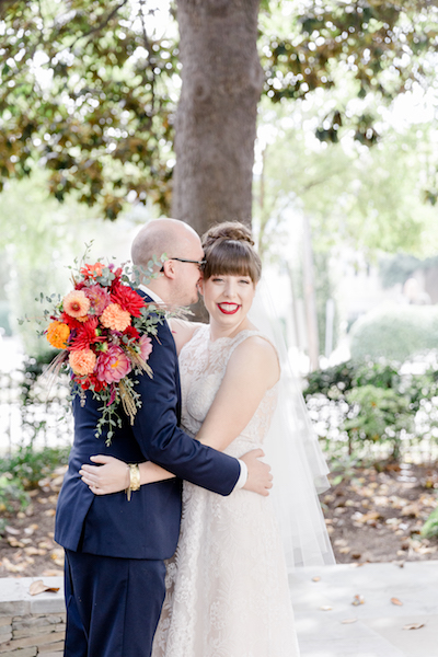 Bride and groom portrait with bridal bouquet in fall colors